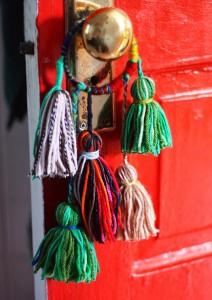 Decoración para la puerta con lanas
